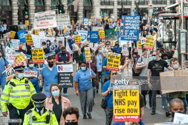 NHS workers march from the BBC headquarters to Trafalgar square to demand a pay rise from the government on September 12 2020 in London England...