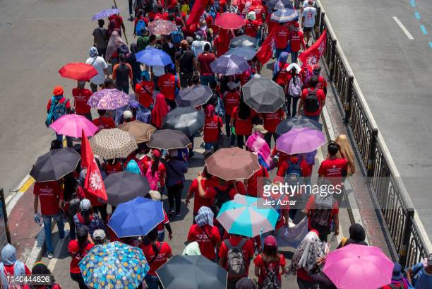 Workers march on the streets to mark International Labor Day on May 1 2019 in Manila Philippines