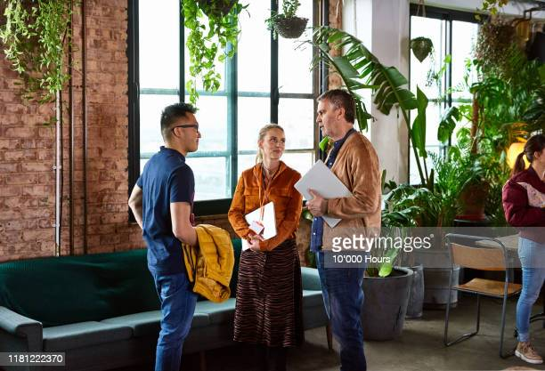 workers meeting for office training day - returning stock pictures, royalty-free photos & images