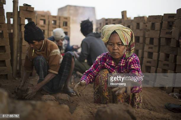Workers mold clay into portions at a brick manufacturing facility near Kengtung Shah State Myanmar on Friday Feb 19 2016 For all the democratic...
