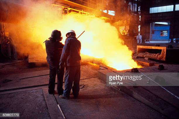 Workers monitor the blast furnace at the Bao Steel mill in Baotou Inner Mongolia China Baotou is an excellent example of a oneindustry town and that...