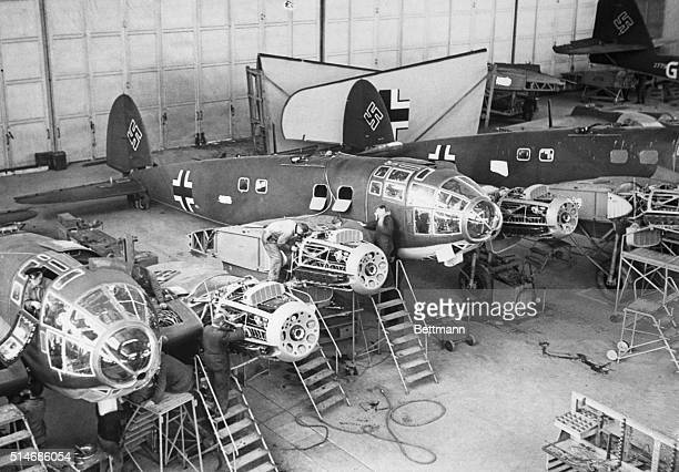 Workers mostly women build combat planes for Germany at a factory during World War II