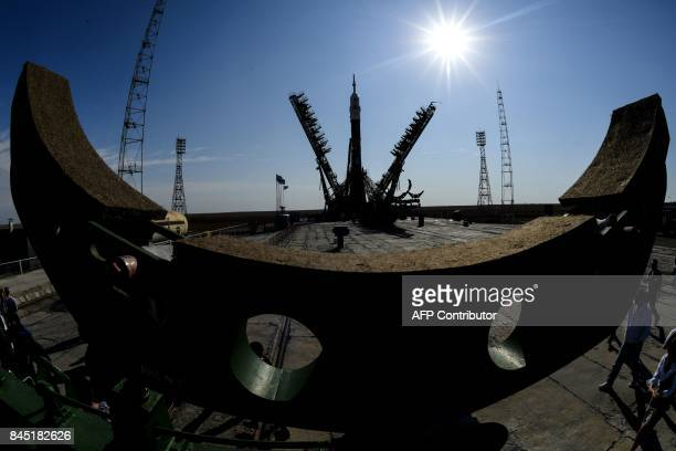 Workers mount a Soyuz MS06 spacecraft onto the launch pad of the Russianleased Baikonur cosmodrome in Kazakhstan on September 10 2017 The launch of...