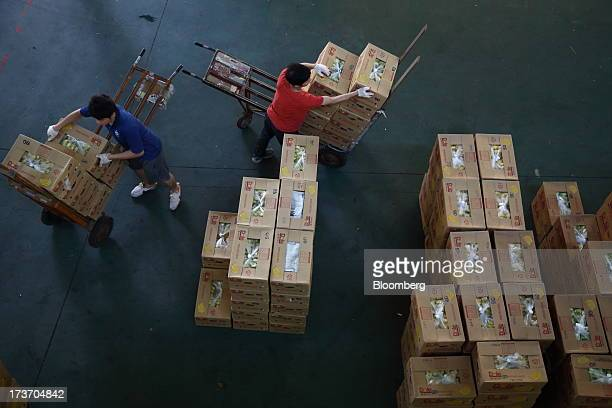 Workers move boxes of Dole Food Co. Bananas at Noeun Agricultural and Marine Products Wholesale Market in Daejeon, South Korea, on Tuesday, July 16,...