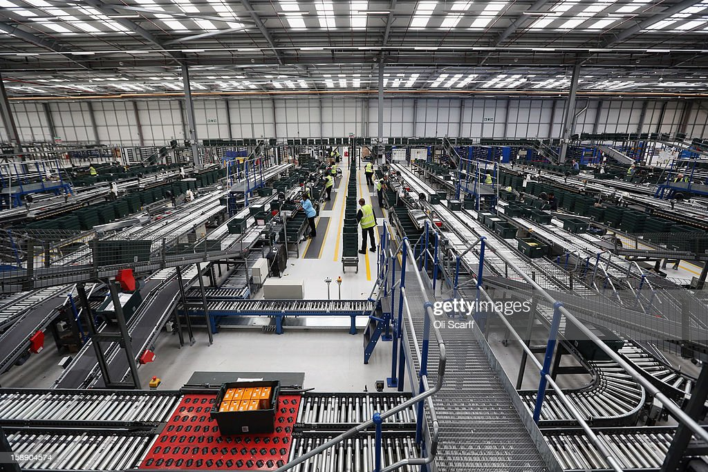 Workers move items along an assembly line in the giant semi-automated distribution centre where the company's partners process the online orders for the John Lewis department store on January 3, 2013 in Milton Keynes, England. John Lewis has published their sales report for the five weeks prior December 29, 2012 which showed online sales had increased by 44.3 per cent over the same period in 2011. Purchases from their website Johnlewis.com now account for one quarter of all John Lewis business.