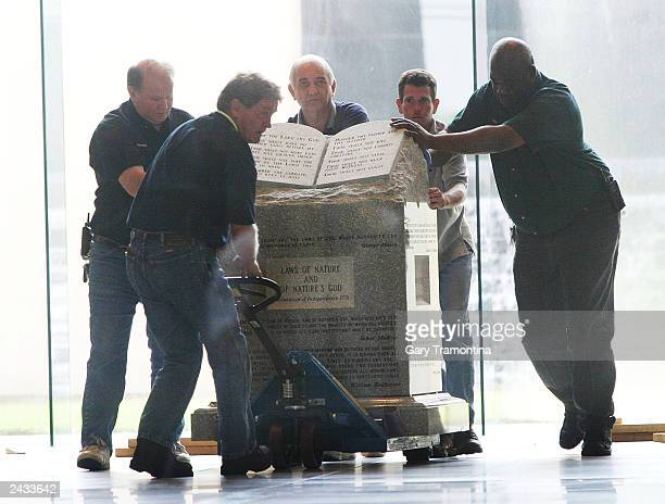 Workers move the Ten Commandments monument from the rotunda of the State Judicial building August 27 2003 in Montgomery Alabama The Ten Commandments...