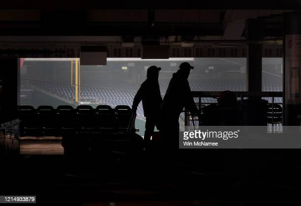 Workers move through the concourse as Nationals Park, home to the World Series Champion Washington Nationals, is empty on the scheduled date for...