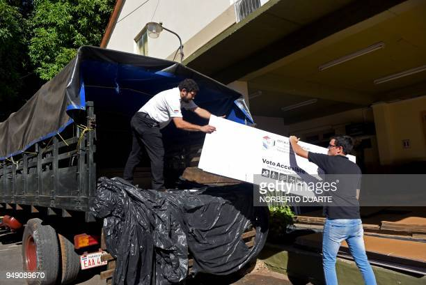 Workers move voting stations ahead of the upcoming April 22 presidential elections in Asunción on April 20 2018 Paraguay will hold presidential...