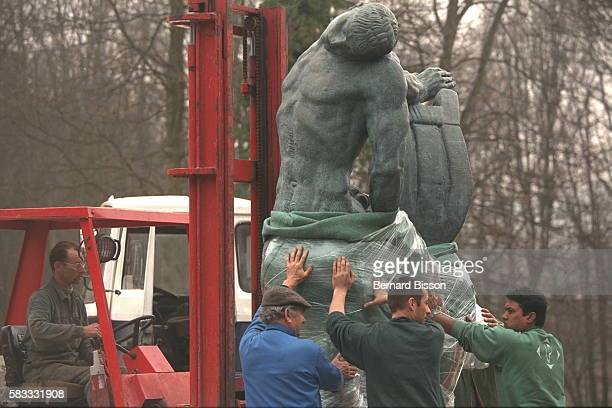 Workers Moving Dying Centaur by EmileAntoine Bourdelle for the Les Champs de la Sculpture Exhibition