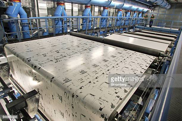 Workers observe the restart of a large rotogravure printing machine at the Prinovis printing plant in Nuremberg southern Germany on Tuesday April 25...