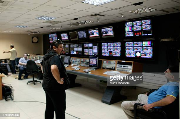 Workers occupy a production suite within the headquarters of the Greek public broadcaster ERT on June 12 2013 in Athens Greece Journalists have...