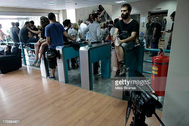 Workers occupy an entrance to the headquarters of the Greek public broadcaster ERT on June 12 2013 in Athens Greece Journalists have refused to leave...