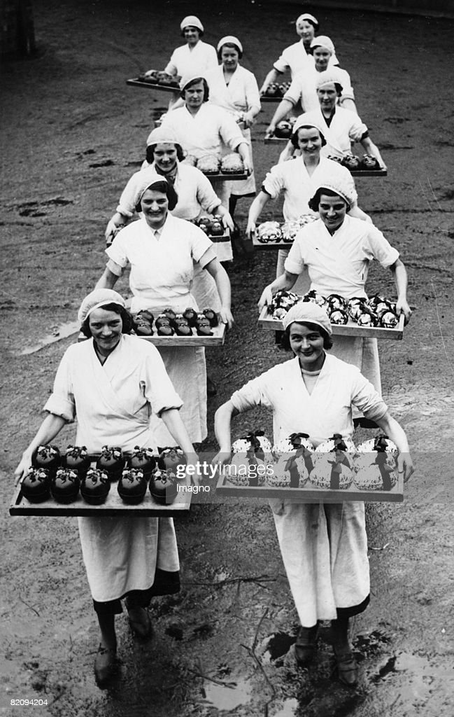 Workers of a chocolate factory with Easter eggs, England, February 17th 1936 : News Photo