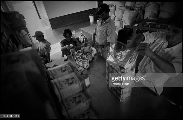 Workers of a cooperative pack the yerba mate that will be distributed in supermarkets in July, 2005 in Tamandua, Argentina. Small cooperatives have...