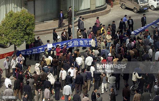 Workers of a textile factory protest about corruption problems in the leadership of the factory at a main road on March 14 2005 in Kunming of Yunnan...