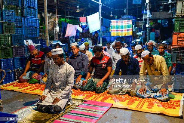 Workers of a wholesale market are seen inside the mosque while praying during the holy month of Ramadan. Ramadan is the Islamic calendar's holistic...