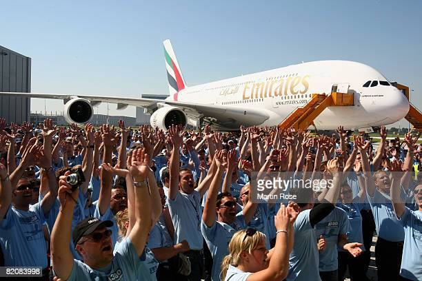 Workers of Airbus celebrate in front of the Airbus A380 on July 28 2008 in Hamburg Germany The world's largest passenger liner built by the European...