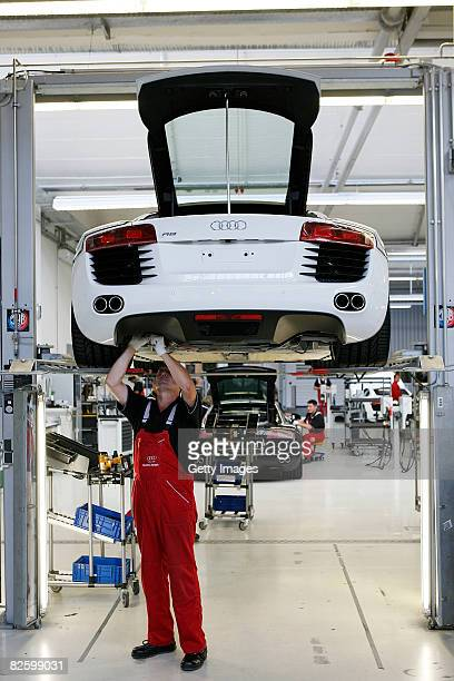 Workers of Audi assemble a Audi R8 sports car at the production line at Audi Forum on August 29 2008 in Neckarsulm Germany