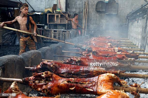 Workers of Brgy Laloma in Quezon City are getting busy to cook the ordered Lechon Baboy for the celebration of NocheBuena according to the...