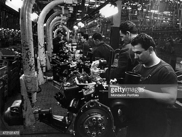 Workers of Fiat working at the assembly line in the plant of Mirafiori Turin 1964