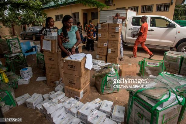 Workers of Independent Nigerian Electoral Commission count identity card readers ahead of the country's elections at an INEC office in Umuahia one of...