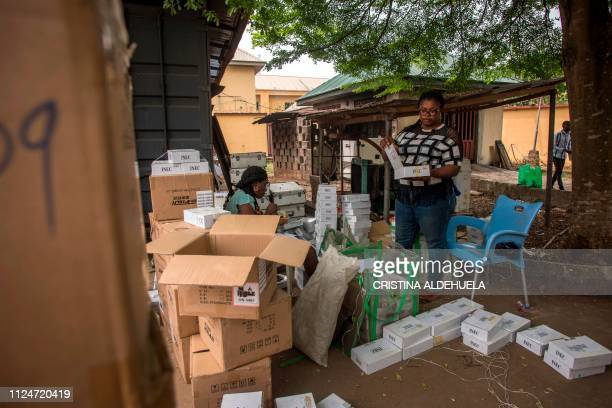 Workers of Independent Nigerian Electoral Commission test identity card readers ahead of the country's elections at an INEC office in Umuahia one of...