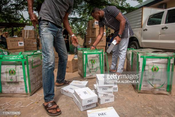 TOPSHOT Workers of Independent Nigerian Electoral Commission test identity card readers ahead of the country's elections at an INEC office in Umuahia...
