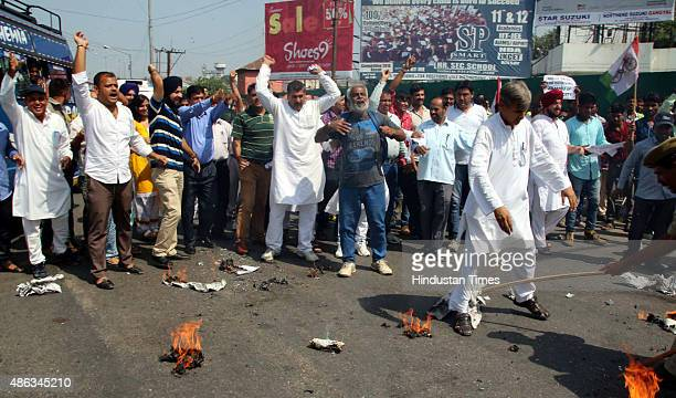 Workers of Jammu and Kashmir National Panthers Party shouting slogans during a protest here against Narendra Modiled NDA government for not including...