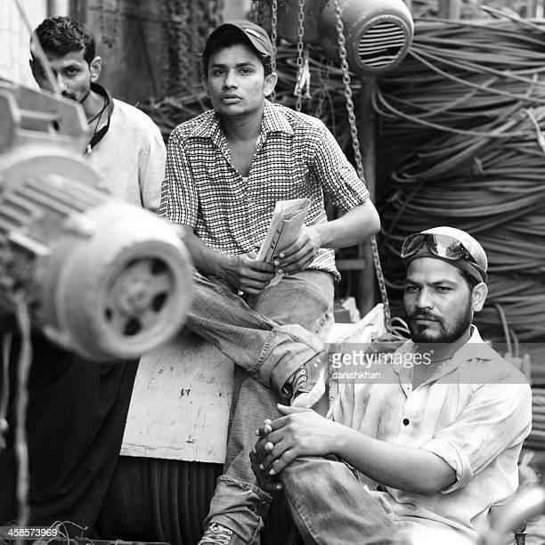 Workers of Karachi Shershah Kabari Bazaar Scrap Market and Junk