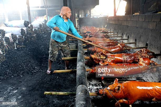 Workers of Laloma in Quezon City are getting busy to cook the ordered Lechon Baboy for the celebration of NocheBuena or new year celebration...