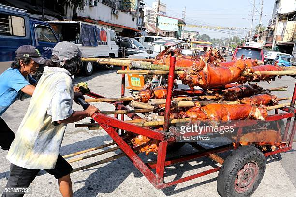 Workers of Laloma in Quezon City is preparing the Lechon Baboy that are ready to pickup for the coming celebration of NocheBuena or new year...