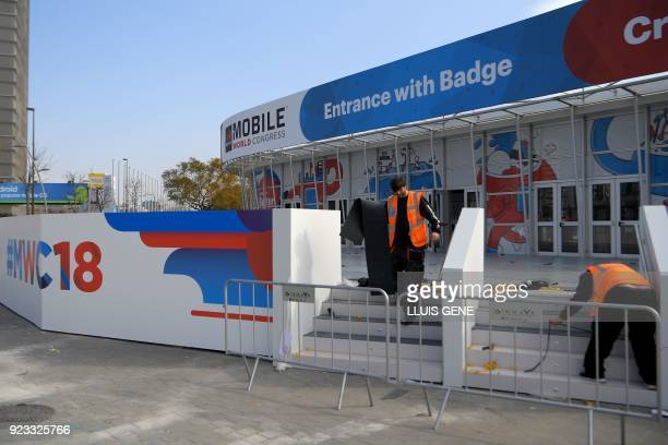 Workers of Mobile World Congress ready the venue's entrance on February 23 ahead of the start of the world's biggest mobile fair held from February...
