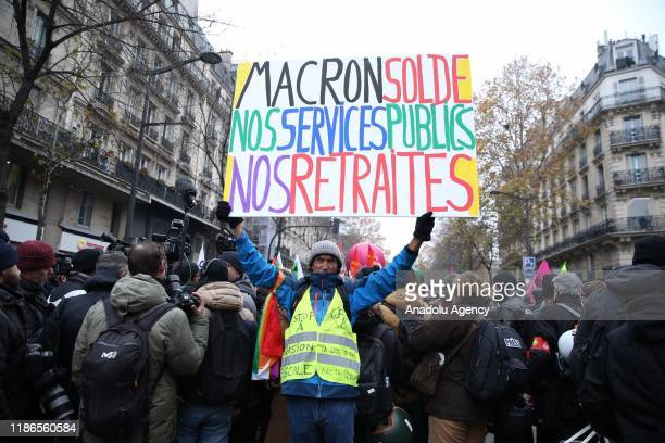 Workers of RATP and SNCF Railway company attend a general strike over French government's plan to overhaul the country's retirement system in Paris...