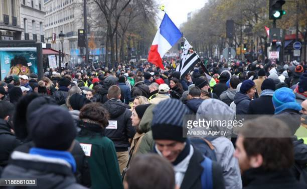 Workers of RATP and SNCF Railway company attend a general strike over French government's plan to overhaul the country's retirement system, in Paris,...