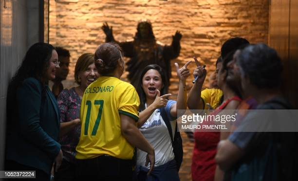 Workers of Rio's archdiocese make Brazilian farright presidential candidate Jair Bolsonaro's typical gestures during his visit in Rio de Janeiro...
