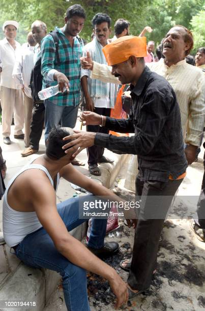 Workers of the Archaeological Survey of India led a protest by shouting slogans and shaving off their hair for their demands at Archaeological Bhawan...