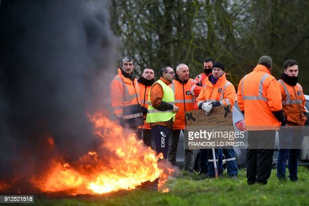 Workers of the Ascoval steel factory of SaintSaulve a branch of conglomerate Ascometal and Vallorec burn tires as they stage a protest by the A2...