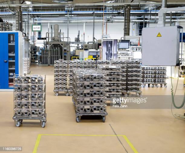 Brandenburg an der Havel Germany July 25 Workers of the automotive supplier ZF Getriebe GmbH work in the factory hall on July 25 2019 in Brandenburg...
