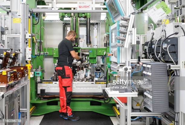 Brandenburg an der Havel Germany July 25 Workers of the automotive supplier ZF Getriebe GmbH work in the factory hall on July 25 2019 in Brandenburg...