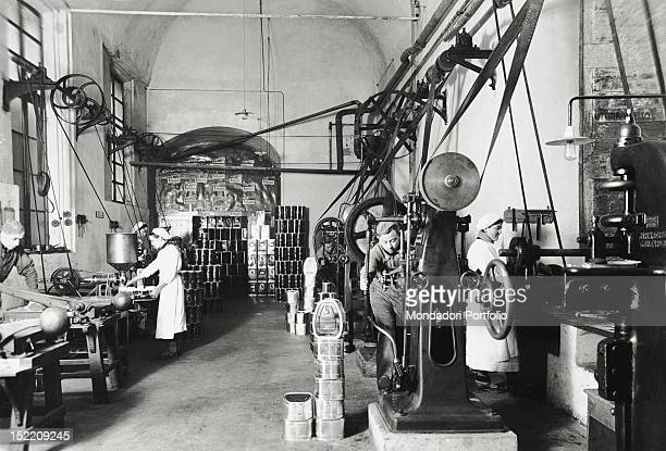 Workers of the Bellentani company in Modena specializing in the production of engines