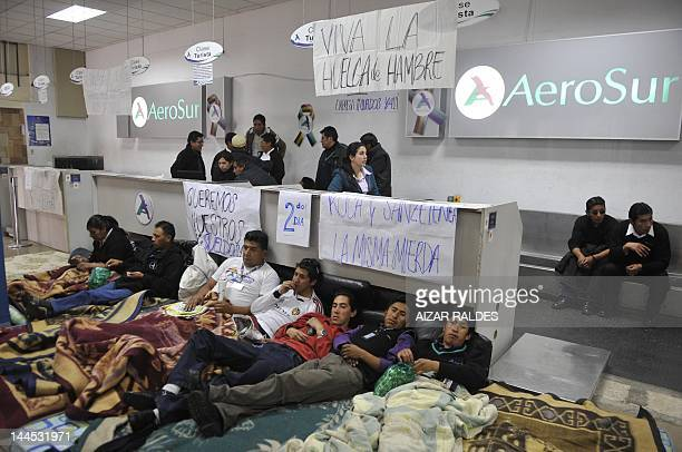 Workers of the Bolivian airliner Aerosur hold their second day of a hunger strike next to the counters of the company at El Alto's international...
