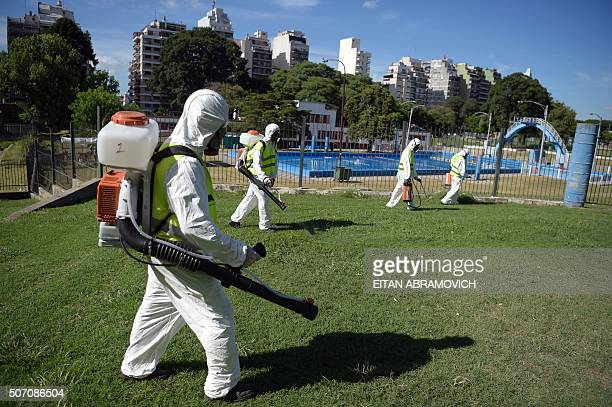 Workers of the Buenos Aires city Ministry of Environment and Public Space fumigate for Aedes aegypti mosquitos to prevent the spread of Dengue fever...