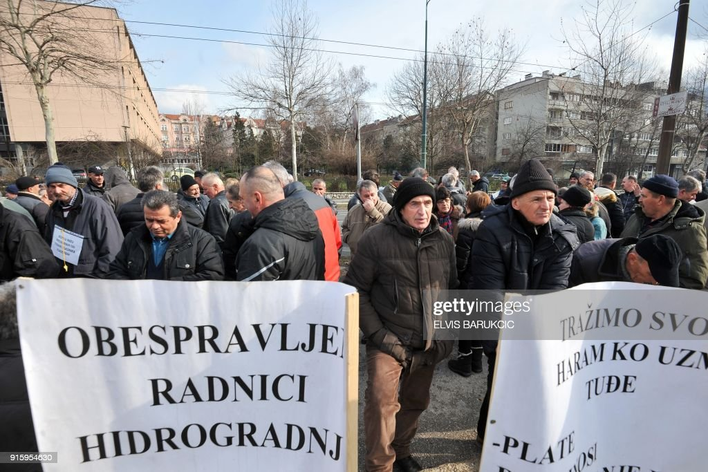 Workers of the construction company 'Hidrogradnja' hold placards as they demonstrate in front of the government building in Sarajevo, on February 5, 2018 to protest against the conditions and social rights of the workers. After Bosnia's war in the 1990s, business gradually went downhill like at many state-run firms hit by both the transition to a market economy for which they were not equipped, and mismanagement. According to trade unions, between 50,000 and 65,000 former or current employees of mostly state companies, such as hospitals, mines or public transport, will not get their pension, as the companies had not been paying into the state pension fund. Tax authorities estimate that unpaid social contributions amount to almost two billion euros, or half of Bosnia's annual national budget. /