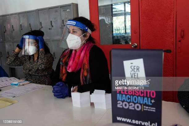 Workers of the Electoral Service of Chile take part in a drill showing the press the sanitary security measures ahead the October 25 referendum to...