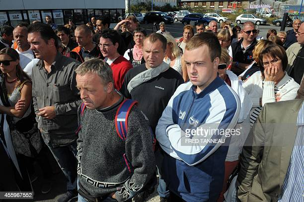 Workers of the French poultry export TillySabco listen to their union representative Corinne Nicole on September 23 2014 in Brest western of France...