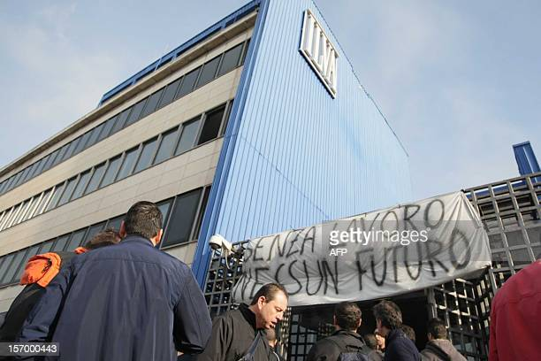 Workers of the ILVA plant stand in front of the offices of the factory during a protest on November 27 2012 in Taranto Hundreds of striking Italian...