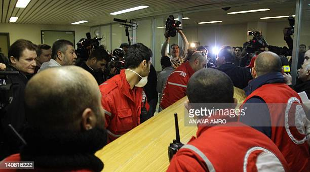 Workers of the International Red Crescent carry the coffin of American journalist Marie Colvin of the Sunday Times in Damascus on March 3 2012 Colvin...