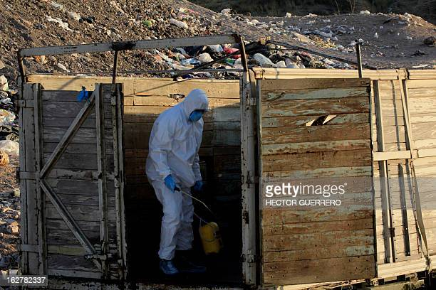 Workers of the Mexican Secretariat of Agriculture Livestock Rural Development Fisheries Nutrition disinfect a truck used to transport chicken in...