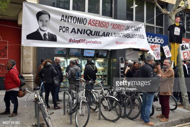 Workers of the newspaper of 'El Periodico' seen holding a banner with the photo of Antonio Asensio Mosbah President of Editorial Z Group during the...