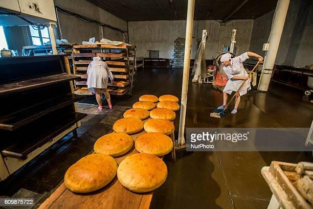 Workers of the Nikitin Kolkhoz bakery clean their kitchen after working day at 10 am Ivanovka village Azerbaijan Bakery makes bread for local people...